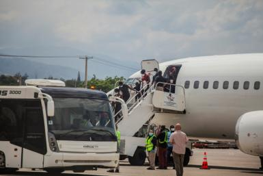 Haitians deported from the United States, some of them after harrowing months-long journeys, arrive at the airport in Port-au-Prince