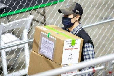 A contractor working for Cyber Ninjas transports ballots from the 2020 general election