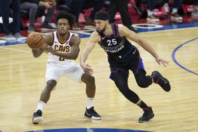 Ben Simmons #25 of the Philadelphia 76ers steals the ball from Collin Sexton #2 of the Cleveland Cavaliers