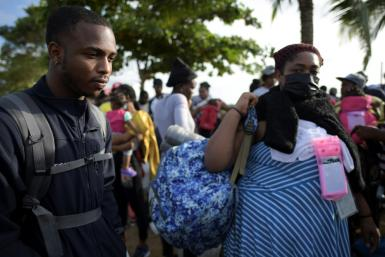 Haitian migrants Benedictine Point Du Jour (R) and her son Roberth are undeterred in their quest to make it to the United States, come what may