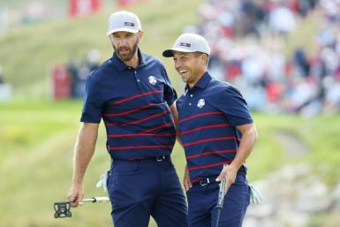 Second-ranked Dustin Johnson, left, and Tokyo Olympic champion Xander Schauffele each won two matches on Friday during the opening day of the 43rd Ryder Cup