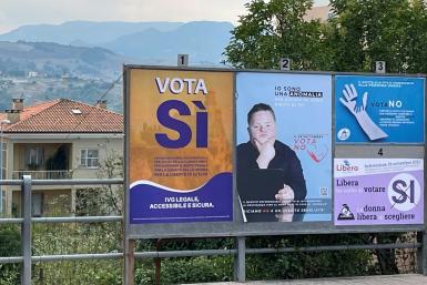 A billboard showing both both pro- and anti-abortion posters in San Marino ahead of the abortion referendum