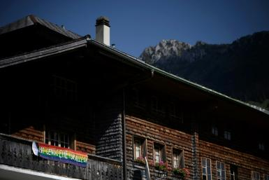 A picture in the Swiss village of Jaun shows a banner in favour of a yes vote