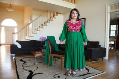 Bahar Jalali, an Afghan-American academic, wears an Afghan traditional dress in her home in Glenwood, Maryland, September 24, 2021