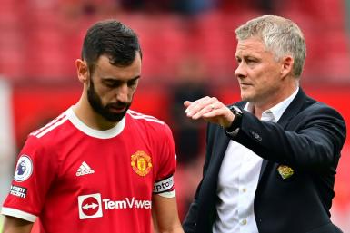 Manchester United boss Ole Gunnar Solskjaer consoles Bruno Fernandes after he missed a penalty in United's 1-0 defeat by Aston Villa