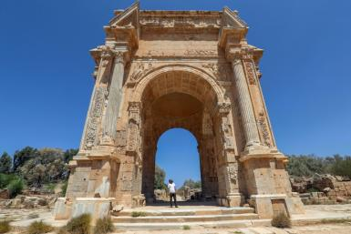 One of the few visitors to the ancient Roman city of Leptis Magna in Libya looks at the Arch of Septimius Severus