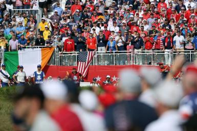 American Xander Schauffele tees off in his singles match against Europe's Rory McIlroy on the final day of the 43rd Ryder Cup