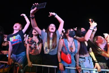 People cheer as Coldplay perform during the 2021 Global Citizen Live festival at the Great Lawn, Central Park on September 25, 2021 in New York City