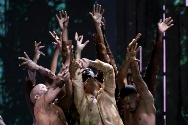 """Dancers perform a scene during a rehearsal for Terence Blanchard's """"Fire Shut Up in My Bones"""""""