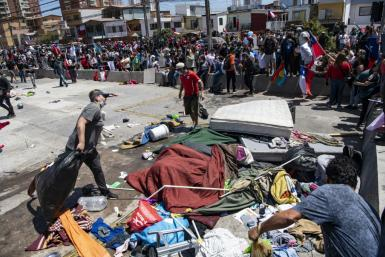 Protesters in Iquique waved Chilean flags and chanted slogans against the migrants