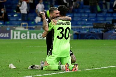 Sheriff's Dimitrios Kolovos and goalkeeper Giorgos Athanasiadis celebrate after beating Real Madrid in the Champions League on Tuesday.