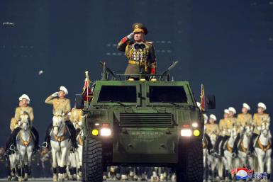 The launch of the new missile was watched by top official Pak Jong Chon, seen here at a parade in January