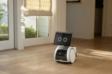 """This handout image courtesy of Amazon.com, Inc. shows the camera-equipped home robot """"Astro"""" patrolling a house"""