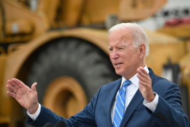 President Joe Biden says Congress must pass his spending plans to keep the US competitive in the world