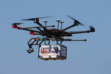 """A drone carrying a box marked """"Flying Sushi"""" is airborne in the Israeli coastal city of Herzliya"""
