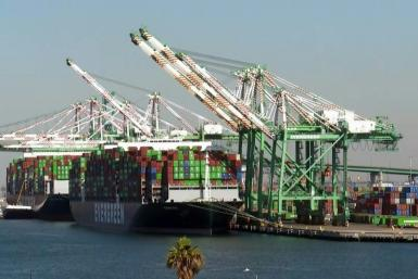 Hundreds of truck drivers wait for dozens of ships to unload their containers in California as the White House announces that it will now work 24 hours a day in an attempt clear the backlog