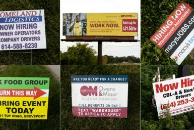Some of the hiring signs posted around Rickenbacker International Airport in Columbus, Ohio as firms look to recruit scarce workers
