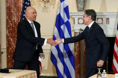 US Secretary of State Antony Blinken and Greek Foreign Minister Nikos Dendias shake hands after signing the renewal of the US-Greece Mutual Defense Cooperation Agreement at the State Department