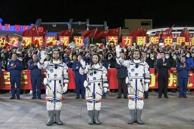 Astronauts (L-R) Ye Guangfu, Wang Yaping and Zhai Zhigang, pictured in a screen grab of footage from Chinese state broadcaster CCTV, blasted off from the Jiuquan Satellite Launch Centre in the Gobi desert, in northwest China on October 16, 2021