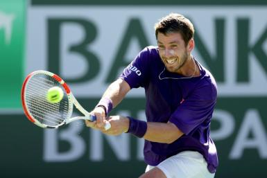 Great Britain's Cameron Norrie returns a shot against Grigor Dimitrov of Bulgaria during the semi-finals ATP Indian Wells Masters in the California desert