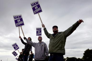 These workers in Davenport, Iowa are among more than 10,000 US employees of the John Deere farm equipment maker now on strike, part of a growing nationwide movement