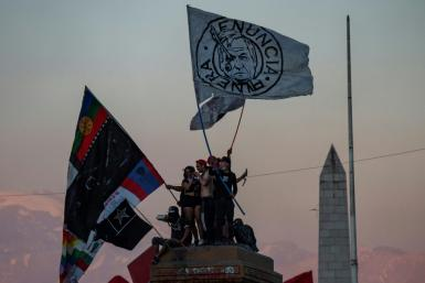 People in Santiago on October 18, 2021 mark the months of unrest two years earlier against inequality in Chile