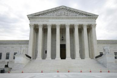The Justice Department asked the Supreme Court to block a Texas law that bans most abortions in the state