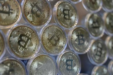 """This file photo taken in December 2020 shows a physical imitation of a Bitcoin at a cryptocurrency """"Bitcoin Change"""" shop in Istanbul"""