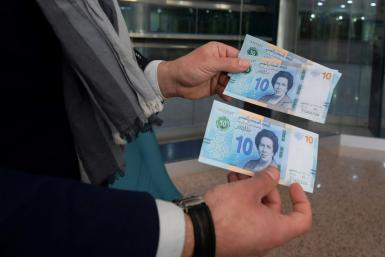 Tunisian bank notes, pictured inside a bank in the capital Tunis, on March 27 2020 -- the country has faced years of economic woes