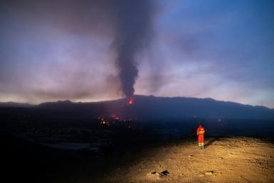 A Spanish Military Emergency Unit picture shows a UME member monitoring the lava flow as geologists warn they do not know how long the eruption will last