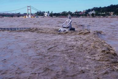A statue of Hindu god Lord Shiva is pictured amid rising water levels of River Ganga after incessant rains in Rishikesh in India's Uttrakhand state