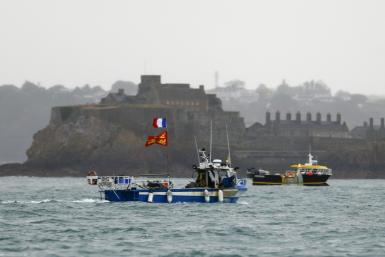 French fishing boats have protested in front off the British island of Jersey to draw attention to what they see as unfair restrictions on their ability to fish in UK waters after Brexit