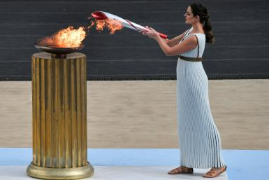 Greek actress Xanthi Georgiou lights the torch at a ceremony in Athens
