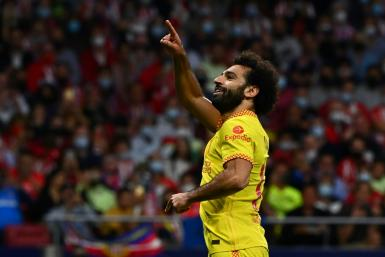 Mohamed Salah scored twice for Liverpool in a dramatic game in Madrid