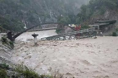 A bridge collapsed following heavy rainfalls in northern India