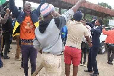 Protesters sing against police violence as unrest hits Eswatini
