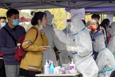 A new Covid-19 outbreak in China has been linked to a group of tourists