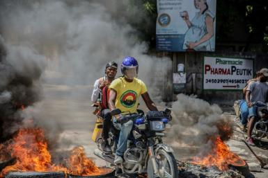 Blazing barricades burn after being set on fire by groups of motorcycle taxi drivers in Port-au-Prince, on October 21, 2021, to protest against fuel shortages.