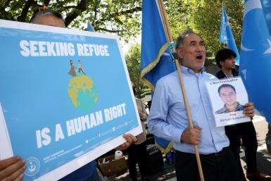 Members of the Uyghur community rally against the Chinese government at the State Department on September 15, 2021 in Washington, DC