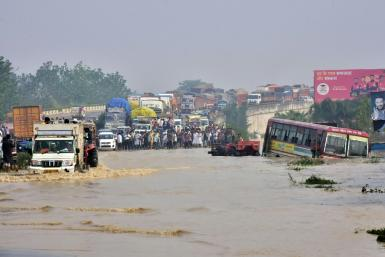 The death toll from days of flooding and landslides in India and Nepal is nearing 200, with whole families buried in their homes as forecasters warned of yet more heavy rain