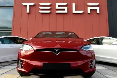 US investigators said a driver was at the wheel of a crashed Tesla, contradicting initial reports