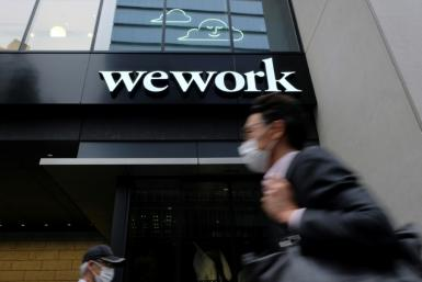 WeWork shares rose in their first session on the Nasdaq
