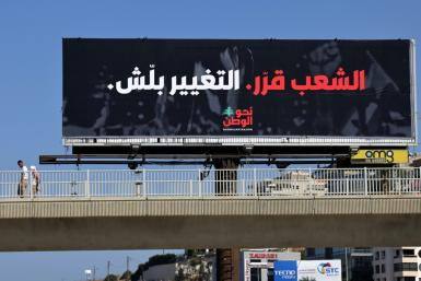 """An electoral billboard reading """"The people have decided, the change has started"""" in Dbayeh, east of Lebanon's capital Beirut, ahead of elections next year"""