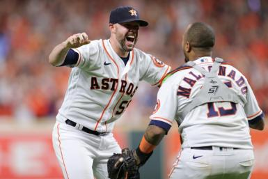 Houston closer Ryan Pressly celebrates with catcher Martin Maldonado after the Astros clinch a 5-0 victory over the Boston Red Sox to seal their World Series place