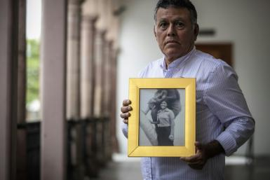Roberto Martinez shows a picture of his sister Lourdes, who disappeared aged 23 in 1974 in Culiacan in northwest Mexico