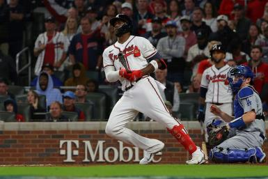 Atlanta's Jorge Soler hits a double during the eighth inning in the Braves 4-2 win over the Los Angeles Dodgers to wrap up their NLCS series in six games