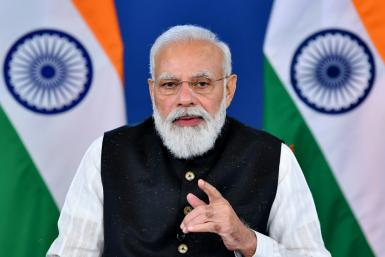 India's Prime Minister Narendra Modi (pictured October 12, 2021) will go to the climate talks in Glasgow after attending the Group of 20 summit in Rome, where rising temperatures will also be a key issue