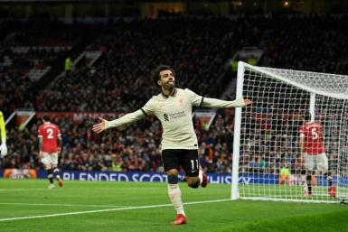 Mohamed Salah celebrates after scoring Liverpool's fifth goal, and his third, at Old Trafford