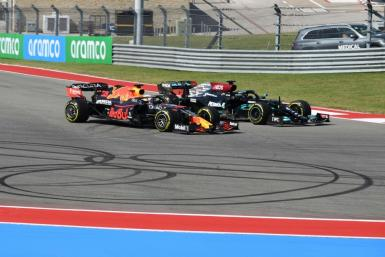 Side-by-side: Max Verstappen (left) and Lewis Hamilton fight for the lead