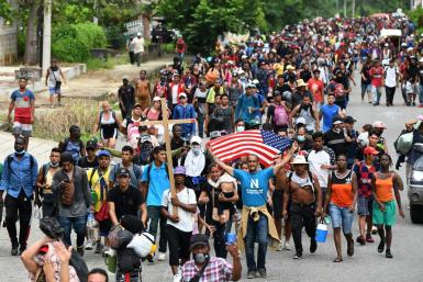 Around 1,000 migrants are marching through southern Mexico towards the capital seeking refugee status